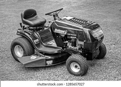 DARLINGTON, NEW BRUNSWICK/CANADA - JULY 8, 2008: One of Bolens MTD 38 inch twin blade lawn tractors as it sits waiting for the operator to cut the lawn.