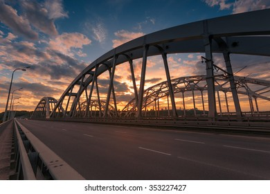 Darnitskiy bridge across Dnepr river against sunset sky. Kiev, Ukraine