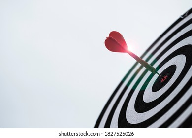 Dart arrow hit dartboard and goal with sunlight ,Setup objectives and target for business investment concept.