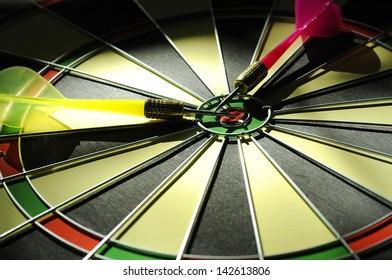 Dart arrows lying in the dart board