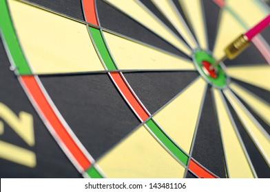 Dart arrows in the target center of dart game