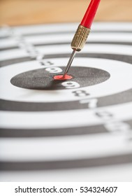 Dart board with arrow in bulls eye, concept image for achievement and success in business