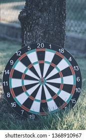 Dart board with arrows hitting the center target