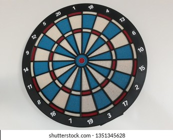 dart board hanging on a wall
