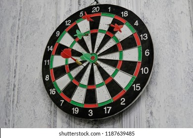 dart board located at the white door without being touched by anyone