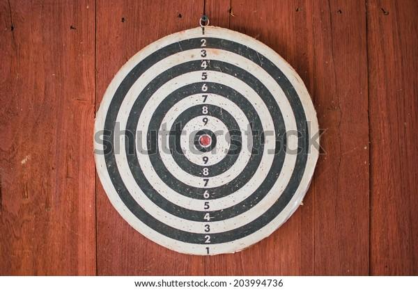 dart board on classical wood wall