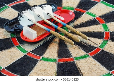 Dart in dart board on white background. indoor games