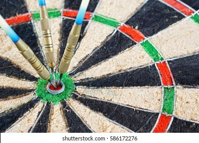 Dart in dart board on white background. indoor games - focus bullseye