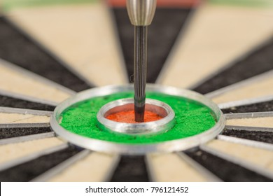 dart in bull's eye, close up green and red