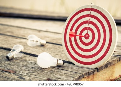 Dart hit the center of dartboard with light bulbs