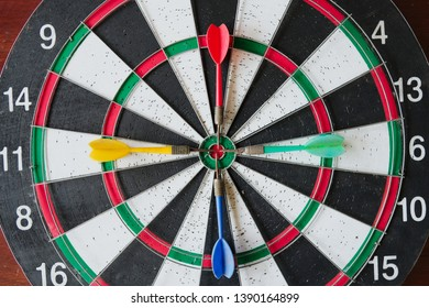 Dart stick on dartboard Close up shot dart arrow on center of dartboard , concept to target success in business