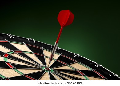 Dart sticks to bullseye on a dart board