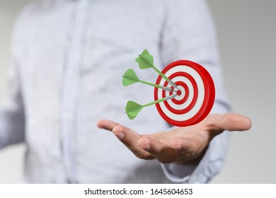dart target arrow hitting on bullseye which is the ultimate goal that everyone wants - Shutterstock ID 1645604653
