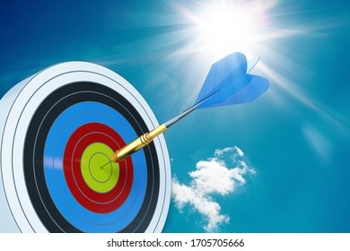 Dart target with an arrow on sky background