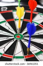 Dartboard with arrow in centre.