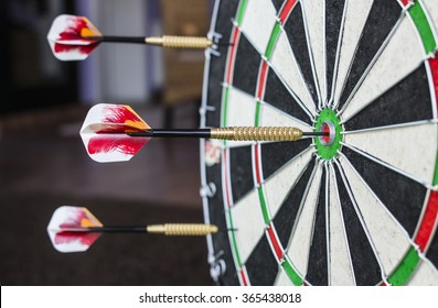 A dartboard close-up with a bullseye hits.