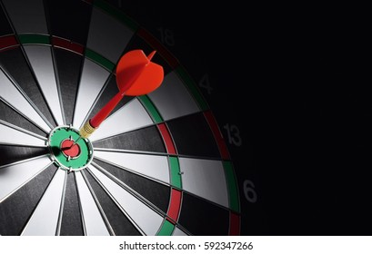 Dartboard with dart arrow hitting the center. Marketing concept.