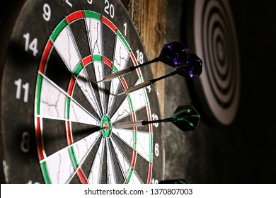 Dartboard with darts, closeup