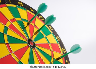 Dartboard on white background (Darts miss the center Target)