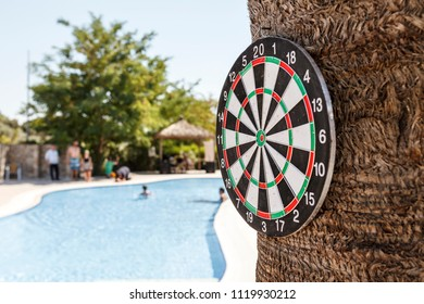 Dartboard at poolside