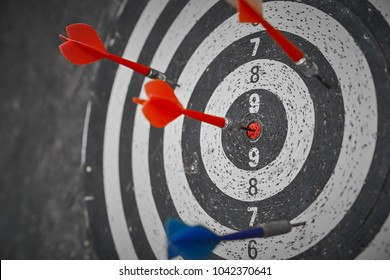 A dartboard receives few hits with one strikes the bull's eye.