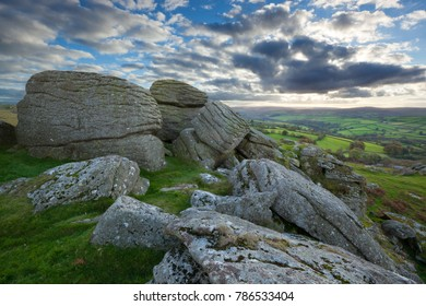 DARTMOOR NATIONAL PARK, DEVON, ENGLAND - OCTOBER 20, 2017: Hollow Tor granite rock outcrop near Widecombe in the Moor with dramatic sky