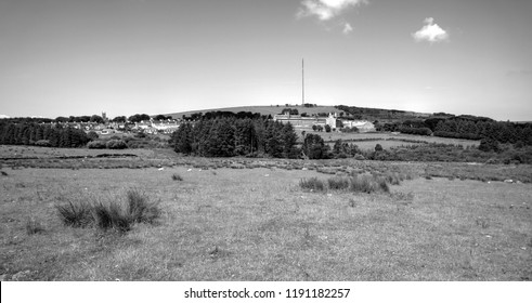Dartmoor prison, Princetown village and radio tower across bleak moorland