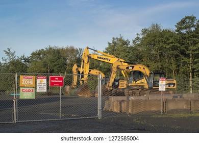 Dartmouth, Canada - June 10, 2017: Construction site with Caterpillar and Komatsu heavy equipment excavators.