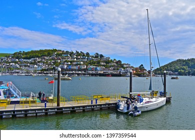 Dartmouth, Devon / England - 5/5/2019: A peaceful & tranquil scene of pleasure boats moored along parts of the River Dart at Dartmouth.View from Dartmouth across the river looking towards Kingswear.