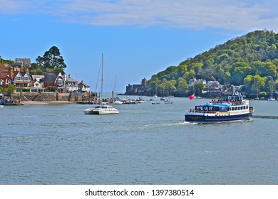 Dartmouth, Devon / England - 5/5/2019: The pleasureboat 'Cardiff Castle' operated by Dartmouth Riverboats, heads away from Dartmouth towards the open sea for a cruise up & down the river Dart.