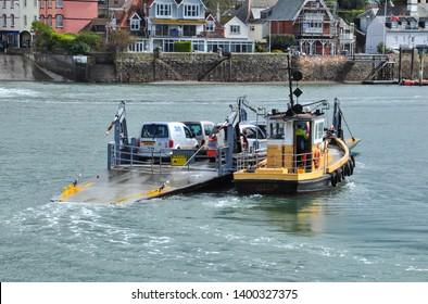 DARTMOUTH, DEVON/UK - April 3, 2019. Lower Car Ferry heads across to Kingswear from Dartmouth, South Devon, England