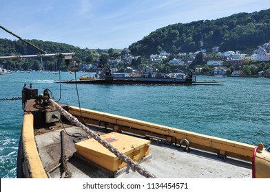 DARTMOUTH, DEVON/UK - June 24, 2018. Tug boat hauling the Lower Vehicle Ferry between Dartmouth and Kingswear (passing the other ferry in background), South Devon, England
