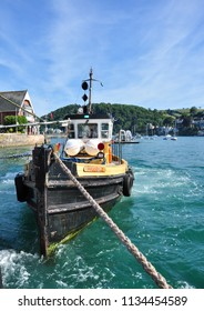 DARTMOUTH, DEVON/UK - June 24, 2018. Tug boat hauling the Lower Vehicle Ferry between Dartmouth and Kingswear, South Devon, England