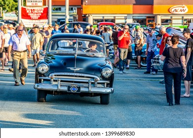 Dartmouth, Nova Scotia, Canada - August 16, 2018 : 1950 Chevy Deluxe entering  weekly A&W Cruise-In at Woodside Ferry terminal parking lot in Dartmouth.