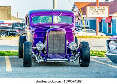 Dartmouth, Nova Scotia, Canada - August 16, 2018 : Purple 1938 Chevrolet hot rod pickup at weekly A&W Cruise-In,  Woodside Ferry terminal parking lot in Dartmouth.