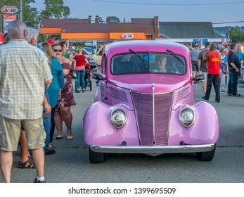 Dartmouth, Nova Scotia, Canada - August 16, 2018 : 1937 Ford sedan streetrod at weekly A&W Cruise-In at Woodside Ferry terminal parking lot in Dartmouth.