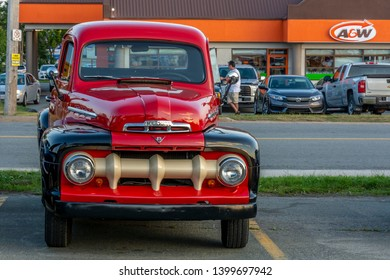 Dartmouth, Nova Scotia, Canada - August 16, 2018 : Two tone red & black 1951 Mercury pickup truck at weekly A&W Cruise-In at Woodside Ferry terminal parking lot in Dartmouth.