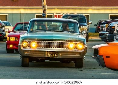 Dartmouth, Nova Scotia, Canada - August 16, 2018 : 1964 Mercury Maurader entering weekly A&W Cruise-In, Woodside Ferry Terminal parking lot, Dartmouth, Nova Scotia.