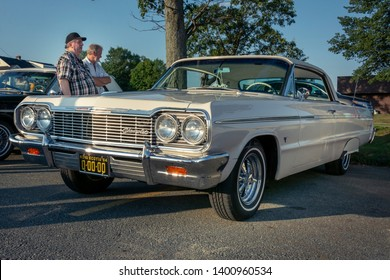 Dartmouth, Nova Scotia, Canada -  August 16, 2018 : Classic 1964 Chevy Impala with fender skirts at A&W weekly summer  cruise-in, Woodside Ferry Terminal parking lot, Dartmouth Nova Scotia.