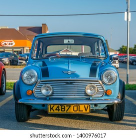 Dartmouth, Nova Scotia, Canada -  August 16, 2018 : Front view of a classic English Mini car at A&W weekly summer cruise-in, Woodside Ferry Terminal parking lot, Dartmouth Nova Scotia.