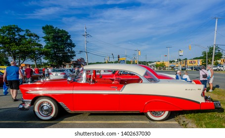 Dartmouth, Nova Scotia, Canada - August 3, 2017 - 1956 Chevrolet Bel Air with fender skirts & continental spare tire rack at A&W weekly Thursday cruise-in, Woodside Ferry Terminal, Nova Scotia.