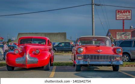 Dartmouth, Nova Scotia, Canada - August 3, 2017 - Front view of customized 1939 Buick Century & 1956 Chevrolet Belair at A&W weekly cruise-in, Woodside Ferry Terminal, Dartmouth, Nova Scotia.