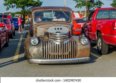 Dartmouth, Nova Scotia, Canada - August 3, 2017: Owner backs his rat rod 1942 Chevrolet pickup truck into a parking space at weekly cruise-in, Woodside Ferry Terminal parking lot, Dartmouth.
