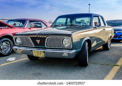 Dartmouth, Nova Scotia, Canada - August 3, 2017 : 1966 Plymouth Valiant at weekly summer A&W Cruise-In at Woodside Ferry Terminal parking lot, Dartmouth Nova Scotia.