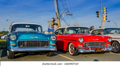 Dartmouth, Nova Scotia, Canada - August 3, 2017 : A pair of 1955 Chevrolets at weekly summer A&W Cruise-In at Woodside Ferry Terminal parking lot, Dartmouth Nova Scotia.