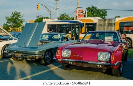 Dartmouth, Nova Scotia, Canada - August 10, 2017 : 1978 Avanti II & 1964 Corvette Sting Ray at weekly A&W summer cruise-in at Woodside Ferry Terminal parking lot, Dartmouth Nova Scotia.