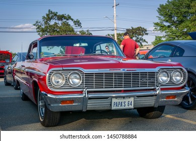 Dartmouth, Nova Scotia, Canada - July 4, 2019 : Red 1964 Chevrolet Impala 2 door hard top at weekly summer A&W Cruise-In at Woodside ferry terminal parking lot.