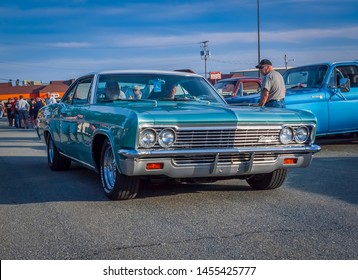 Dartmouth, Nova Scotia, Canada - July 18, 2019 : 1966 Chevrolet Impala SS at weekly summer A&W Cruise-In at Woodside ferry terminal parking lot.