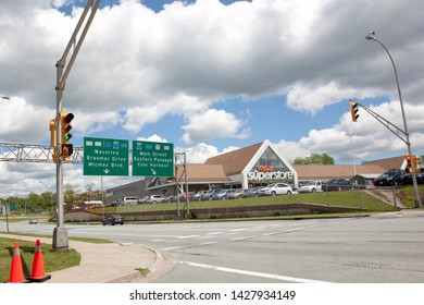Dartmouth, Nova Scotia, Canada- June 15, 2019: Intersection of a busy and popular park and Superstore in Dartmouth