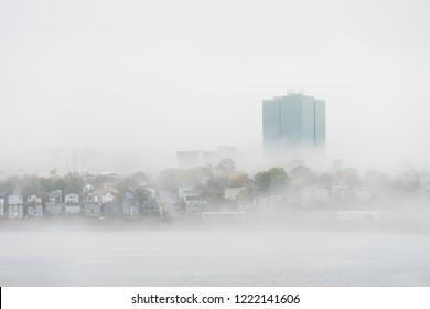Dartmouth, Nova Scotia / Canada - October 28 2018: Fog enshrouding the Dartmouth waterfront